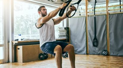 young-man-workout-with-trx-suspension-royalty-free-image-1572858455